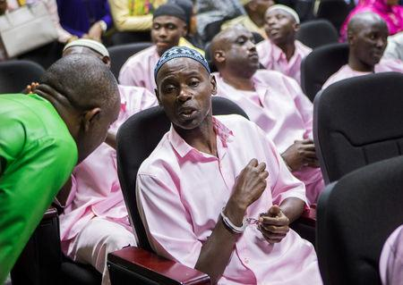 Unidentified suspects talk inside the Rwandan high court after being convicted of belonging to extremist groups including al Shabaab and Islamic State and providing them support, in Nyanza, Rwanda March 22, 2019. REUTERS/Jean Bizimana