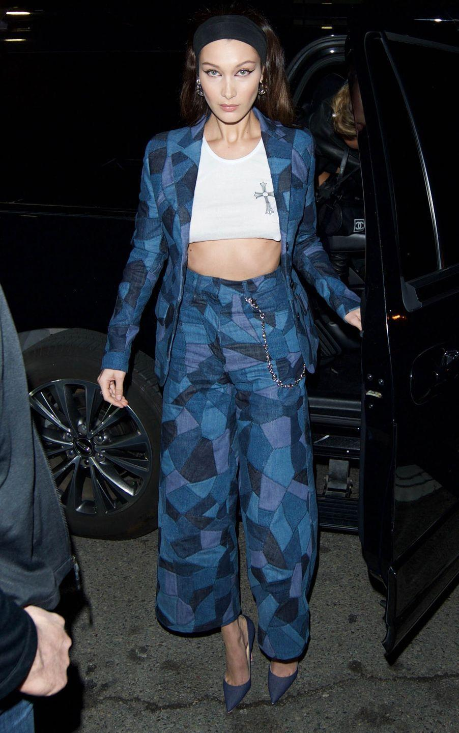 <p>In a patchwork suit from Dior's fall 2018 collection, cropped white tee, and denim pumps while out in LA.</p>