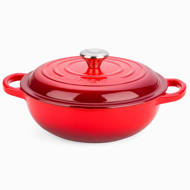 The Le Creuset $295 shallow stew pot in red