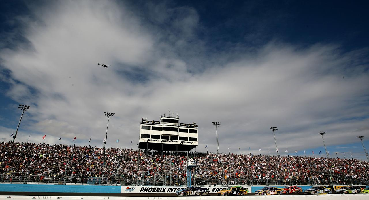 AVONDALE, AZ - NOVEMBER 13:  Matt Kenseth, driver of the #17 Crown Royal Ford, leads the field at the start of the NASCAR Sprint Cup Series Kobalt Tools 500 at Phoenix International Raceway on November 13, 2011 in Avondale, Arizona.  (Photo by Jerry Markland/Getty Images for NASCAR)