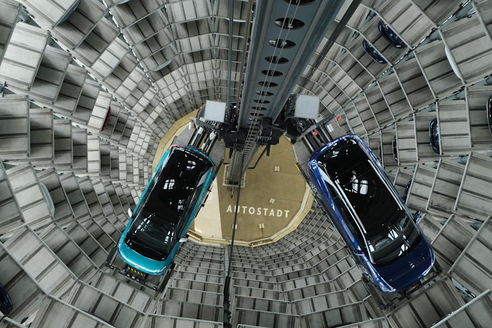 Volkswagen ID.4 (R) and ID.3 electric cars inside one of the twin towers used as storage at the Autostadt promotional facility next to the Volkswagen factory in Wolfsburg, Germany. Photo: Sean Gallup/Getty Images