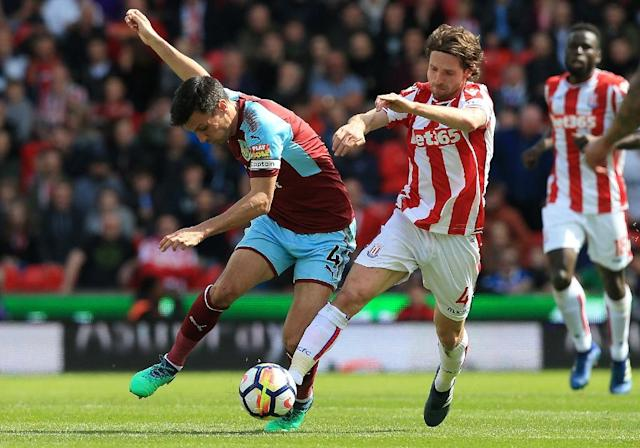 Wales international midfielder Joe Allen signed a new four year contract with second tier Stoke City saying he owes it to them to get them back into the Premier League after failing to keep them up last term (AFP Photo/Lindsey PARNABY)