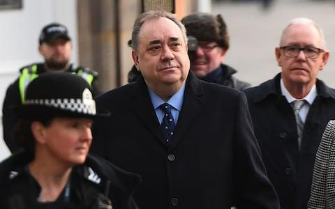 Alex Salmond (C) arrives for a preliminary hearing over allegations of sexual harassment, at the High Court in Edinburgh - Credit: AFP