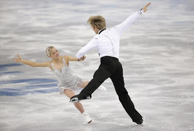 Penny Coomes and Nicholas Buckland of Britain compete in the ice dance short dance figure skating competition at the Iceberg Skating Palace during the 2014 Winter Olympics, Sunday, Feb. 16, 2014, in Sochi, Russia