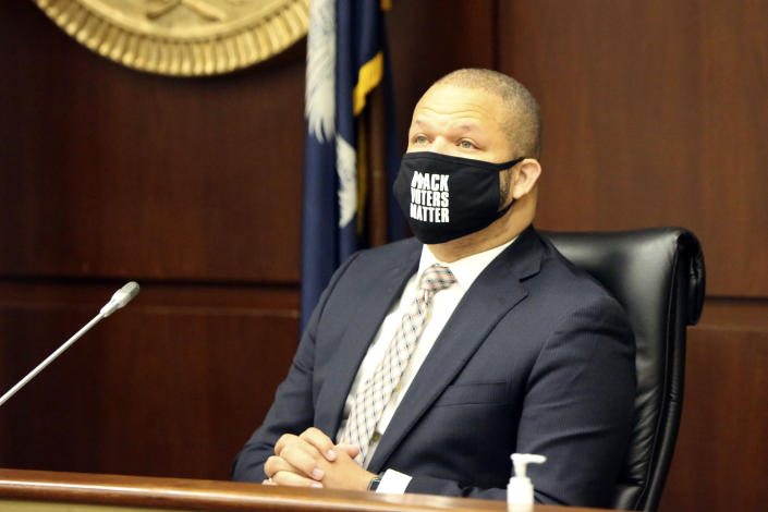 State Rep. John King, D-Rock Hill, listens to testimony about a bill that would expand voting in South Carolina, Thursday, April 15, 2021, in Columbia, S.C. Republicans held a hearing on the bill, but only allowed less than an hour of testimony. (AP Photo/Jeffrey Collins)