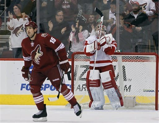 Phoenix Coyotes' Boyd Gordon (15) skates past Detroit Red Wings goalie Joey MacDonald after Gordon scored a short-handed goal during the first period in an NHL hockey game Monday, Feb. 6, 2012, in Glendale, Ariz.(AP Photo/Ross D. Franklin)