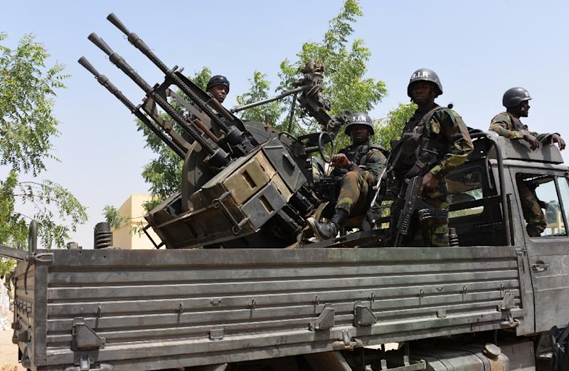 Cameroon soldiers patrol in city of Waza on February 17, 2015 as part of operations against Boko Haram