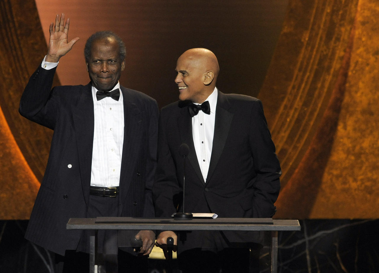 Sidney Poitier, left, and Harry Belafonte speak onstage at the 43rd NAACP Image Awards on Friday, Feb. 17, 2012, in Los Angeles. (AP Photo/Chris Pizzello)