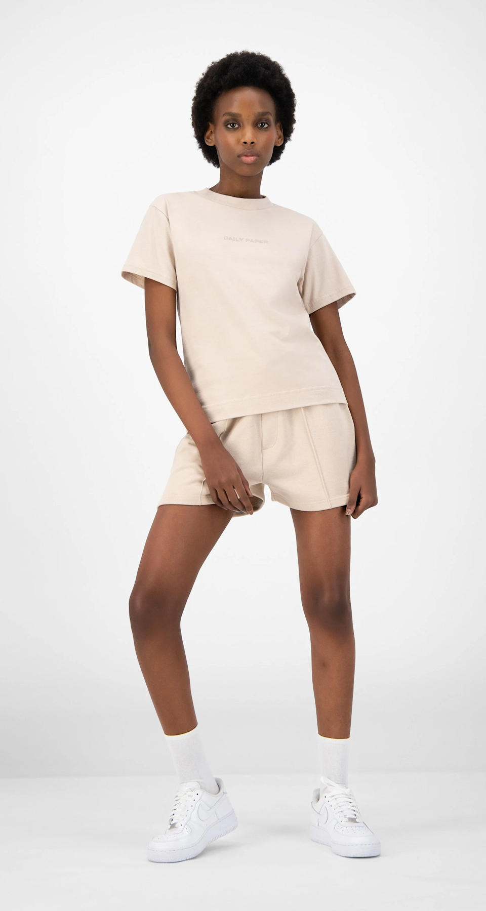 """<h2>Daily Paper</h2><br><br><strong>Daily Paper</strong> Beige Ehot Shorts, $, available at <a href=""""https://go.skimresources.com/?id=30283X879131&url=https%3A%2F%2Fwww.dailypaperclothing.com%2Fcollections%2Fwomen-shorts%2Fproducts%2Fbeige-ehot-shorts"""" rel=""""nofollow noopener"""" target=""""_blank"""" data-ylk=""""slk:Daily Paper"""" class=""""link rapid-noclick-resp"""">Daily Paper</a><br><br><strong>Daily Paper</strong> Beige Estan T-Shirt, $, available at <a href=""""https://go.skimresources.com/?id=30283X879131&url=https%3A%2F%2Fwww.dailypaperclothing.com%2Fcollections%2Fwomen-all%2Fproducts%2Fbeige-estan-t-shirt"""" rel=""""nofollow noopener"""" target=""""_blank"""" data-ylk=""""slk:Daily Paper"""" class=""""link rapid-noclick-resp"""">Daily Paper</a>"""