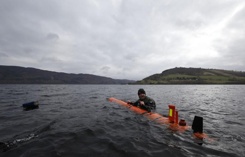 John Haig alongside the Munin AUV (Autonomous Underwater Vehicle) at Loch Ness, as Nessie hunters were left disappointed when monster remains uncovered at the bottom of the loch turned out to be a 1970s film prop.