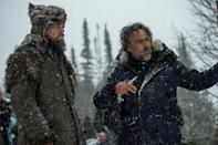 <p>Leonardo DiCaprio and Alejandro González Iñárritu bundle up as they discuss a scene on the set of The Revenant. Leonardo DiCaprio earned his first Oscar for his role in the movie.</p>