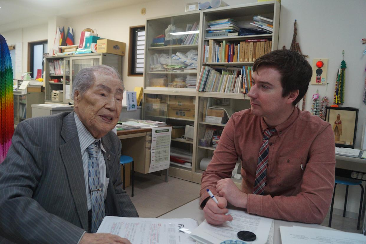 Sunao Tsuboi, 92, a survivor of the atomic bombing of Hiroshima, tells Yahoo News journalist Michael Walsh about his life and thoughts on contemporary politics. (Photo: Michael Walsh/Yahoo News)
