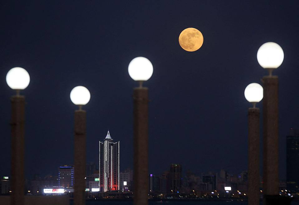 The full Strawberry moon, the last super moon of the year, rises above Kuwait City, on June 24, 2021.