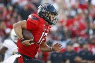 Texas Tech's Tyler Shough (12) runs with the ball during the first half of an NCAA college football game against Florida International, Saturday, Sept. 18, 2021, in Lubbock, Texas. (AP Photo/Brad Tollefson)
