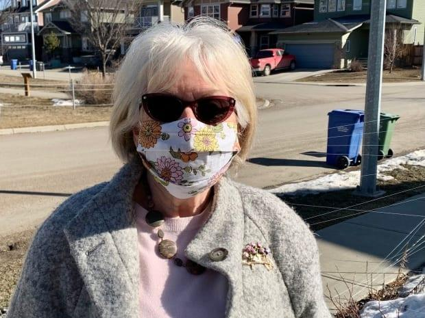 Susan Russell, the president of Okotoks Garden Club wants the town to allow residents to put up makeshift fences and bring in harsher punishments for people who feed and attract deer to residential neighbourhoods. (Dan McGarvey/CBC - image credit)