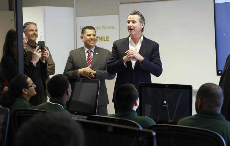 FILE - In this Jan. 22, 2019 file photo, Gov. Gavin Newsom, right, addresses youthful offenders taking a computer coding class at the O.H. Close Youth Correctional Facility in Stockton, Calif. Legionnaires' disease bacteria that killed one inmate and sickened another is more widespread than expected in a California state prison, officials said Wednesday, April 17, 2019, citing new test results. Preliminary results found the bacteria in the water supply at a prison medical facility in Stockton and at two neighboring youth correctional facilities, said Corrections Department spokeswoman Vicky Waters. (AP Photo/Rich Pedroncelli, File)