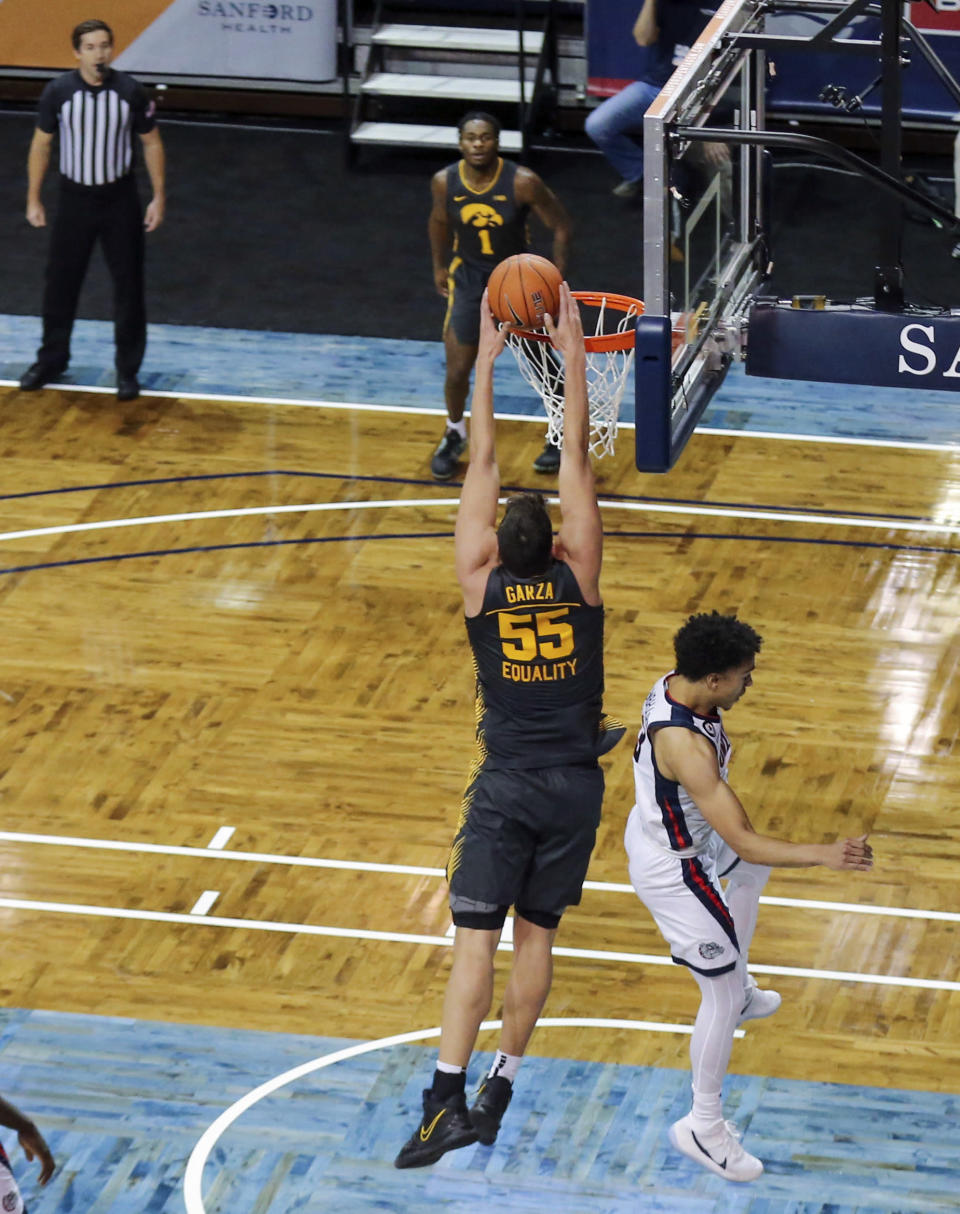 Iowa center Luka Garza (55) dunks the basketball over a Gonzaga defender during the first half of an NCAA college basketball game Saturday, Dec. 19, 2020 in SIoux Falls, S.D. (AP Photo/Josh Jurgens)