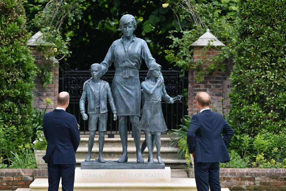 The Duke of Cambridge (left) and Duke of Sussex look at the statue they commissioned of Diana, in the Sunken Garden at Kensington Palace (PA)