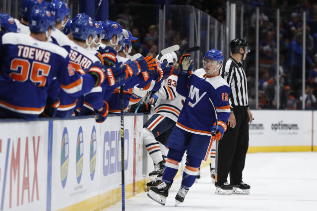 New York Islanders congratulate left wing Anthony Beauvillier (18) after he scored during the first period of an NHL hockey game against the Edmonton Oilers, Tuesday, Oct. 8, 2019, in Uniondale, N.Y. (AP Photo/Kathy Willens)