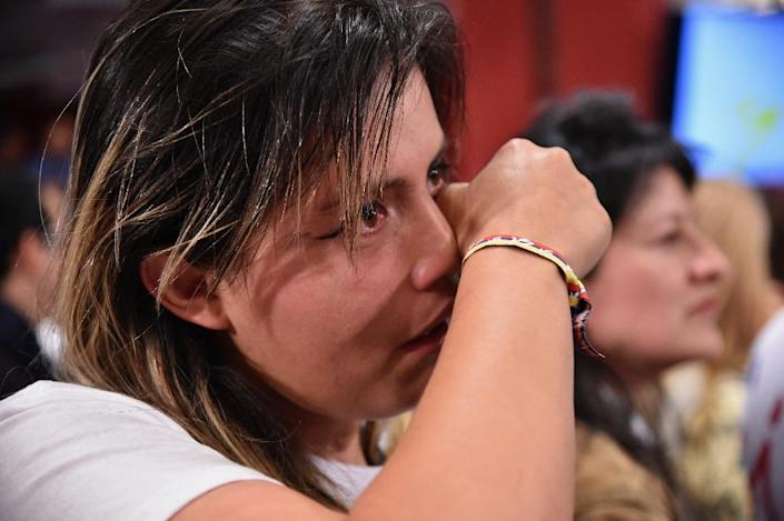 A woman cries after knowing the results of a referendum on whether to ratify a historic peace accord to end a 52-year war between the state and the communist FARC rebels, in Bogota on October 2, 2016 (AFP Photo/Guillermo Legaria)