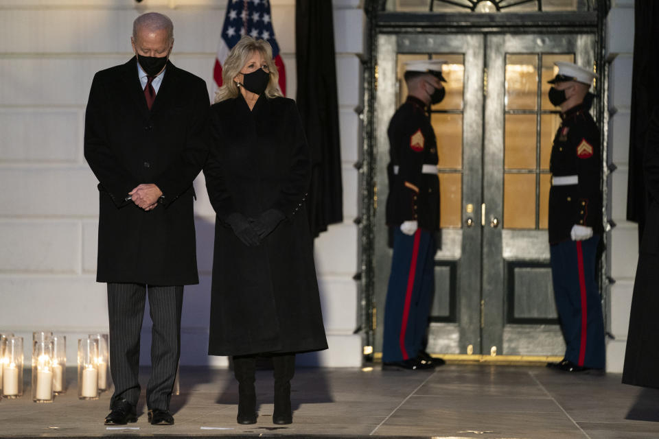 President Joe Biden and first lady Jill Biden participate in a moment of silence during a ceremony to honor the 500,000 Americans that died from COVID-19, at the White House, Monday, Feb. 22, 2021, in Washington. (AP Photo/Evan Vucci)