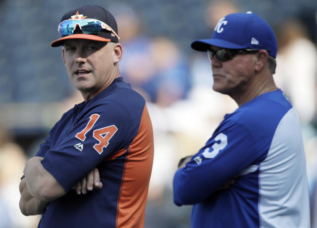 Houston Astros manager AJ Hinch (14) looks over his shoulder while talking with Kansas City Royals manager Ned Yost before a baseball game at Kauffman Stadium in Kansas City, Mo., Friday, June 15, 2018. (AP Photo/Orlin Wagner)