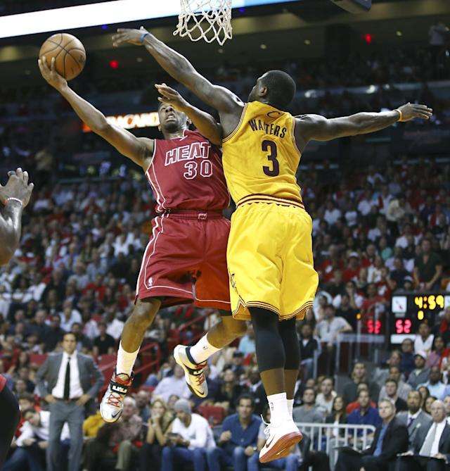 Cleveland Cavaliers' Dion Waiters (3) tries to block Miami Heat's Norris Cole (30) during the first half of an NBA basketball game in Miami, Saturday, Dec. 14, 2013. (AP Photo/J Pat Carter)