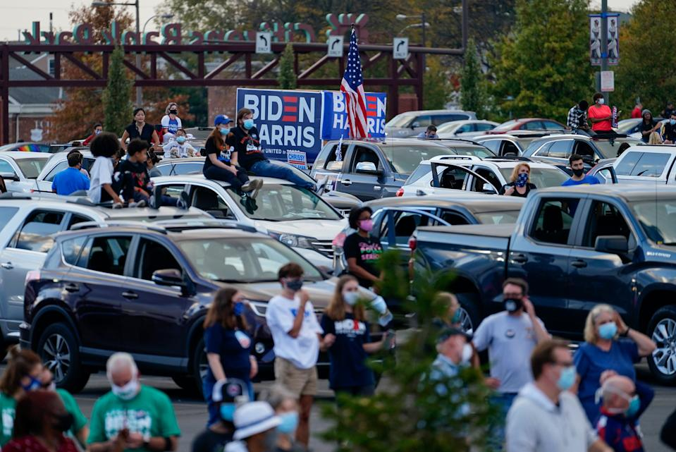 People wait for a campaign event with former President Barack Obama at Citizens Bank Park as he campaigns for Democratic presidential candidate Joe Biden, his former vice president, on Oct. 21, 2020, in Philadelphia.