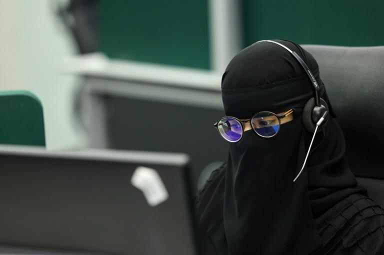 A woman works in a command-and-control room in Mecca ahead of the annual pilgrimage in the holy city