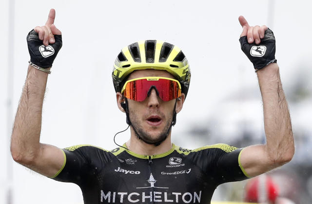 Britain's Simon Yates celebrates as he crosses the finish line to win the fifteenth stage of the Tour de France cycling race over 185 kilometers (114,95 miles) with start in Limoux and finish in Prat d'Albis, France, Sunday, July 21, 2019. (AP Photo/Christophe Ena)