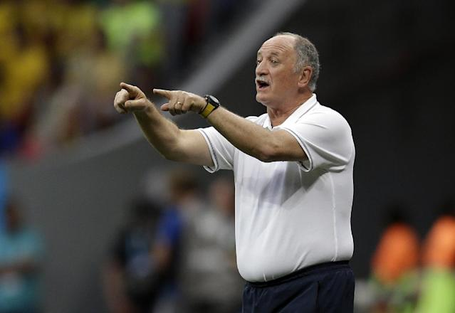 Brazil's coach Luiz Felipe Scolari gives directions to his team during the World Cup third-place soccer match between Brazil and the Netherlands at the Estadio Nacional in Brasilia, Brazil, Saturday, July 12, 2014. (AP Photo/Natacha Pisarenko)