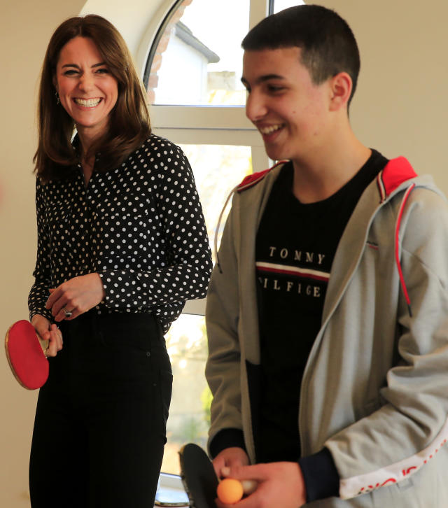 The Duchess of Cambridge enjoys table tennis with one of the guests. (Press Association)