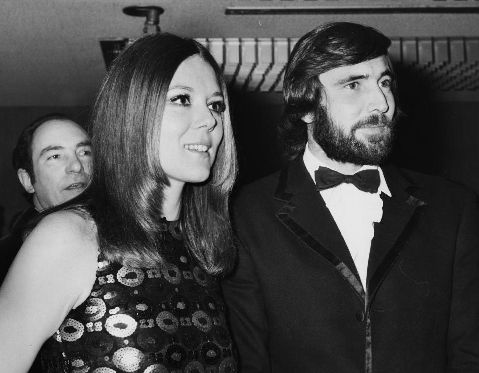 Actors Diana Rigg and George Lazenby at the premiere of the new James Bond film 'On Her Majesty's Secret Service' at the Odeon Theatre in Leicester Square, London, December 18th 1969. (Photo by Leonard Burt/Central Press/Getty Images)