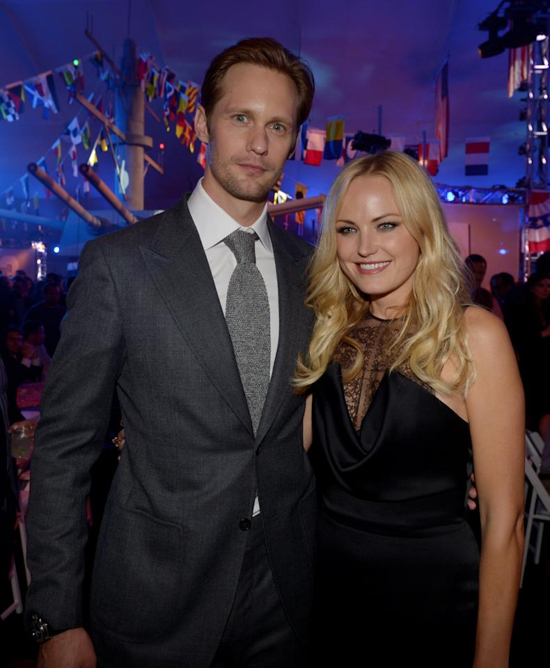 "LOS ANGELES, CA - MAY 10:  Actors Alexander Skarsgard (L) and Malin Akerman pose at the after party for the premiere of Universal Pictures' ""Battleship"" at L.A. Live on May 10, 2012 in Los Angeles, California.  (Photo by Kevin Winter/Getty Images)"