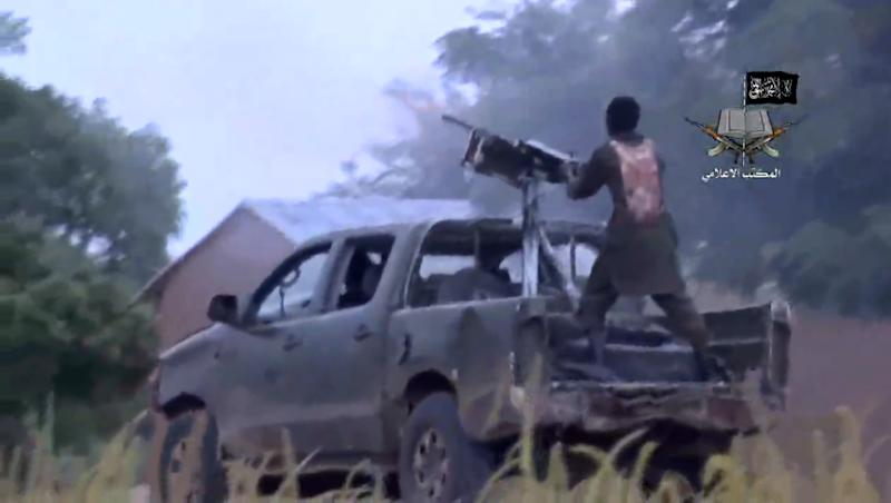A screengrab taken on August 24, 2014 from a video released by the Nigerian Islamist extremist group Boko Haram and obtained by AFP shows alleged members of the Nigerian Islamist extremist group Boko Haram during fighting at an undisclosed location (AFP Photo/Ho)