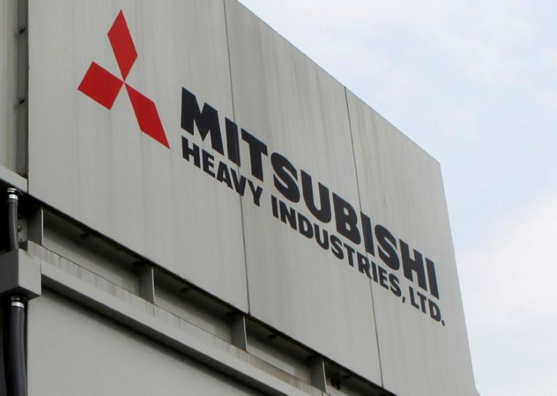 FILE PHOTO: The logo of Mitsubishi Heavy Industries is seen at the company's Sagamihara plant in Sagamihara, Japan