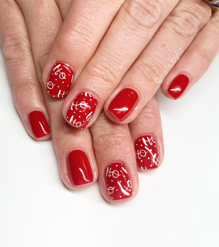 "<p>If you're looking to take a red manicure to the next level this Christmas, try out this fun ""ho, ho, ho"" design by <a href=""https://www.instagram.com/nails.byliz/"" rel=""nofollow noopener"" target=""_blank"" data-ylk=""slk:Utah-based nail technician Liz Henson"" class=""link rapid-noclick-resp"">Utah-based nail technician Liz Henson</a>.</p><p><a class=""link rapid-noclick-resp"" href=""https://go.redirectingat.com?id=74968X1596630&url=https%3A%2F%2Fwww.sephora.com%2Fproduct%2Fgel-lab-pro-nail-polish-P404918%3FskuId%3D1991801%26icid2%3Dproducts%2Bgrid%253Ap404918&sref=https%3A%2F%2Fwww.oprahmag.com%2Fbeauty%2Fg34113691%2Fchristmas-nail-ideas%2F"" rel=""nofollow noopener"" target=""_blank"" data-ylk=""slk:SHOP RED POLISH"">SHOP RED POLISH</a></p>"