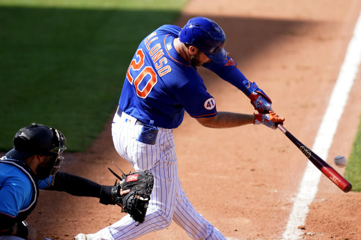 New York Mets' Pete Alonso (20) hits an RBI double to score Mallex Smith during the sixth inning of a spring training baseball game against the Miami Marlins, Friday, March 12, 2021, in Port St. Lucie, Fla. (AP Photo/Lynne Sladky)