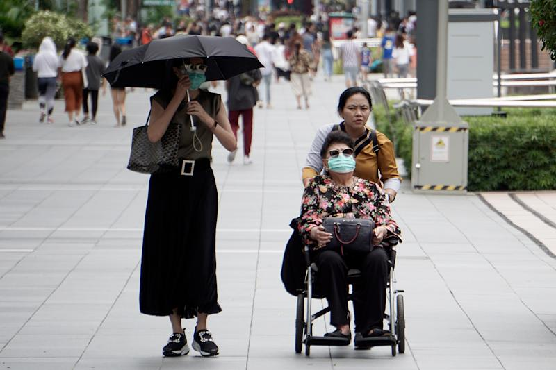 An elderly woman in a wheelchair seen in Orchard Road on 21 March 2020. (PHOTO: Dhany Osman / Yahoo News Singapore)