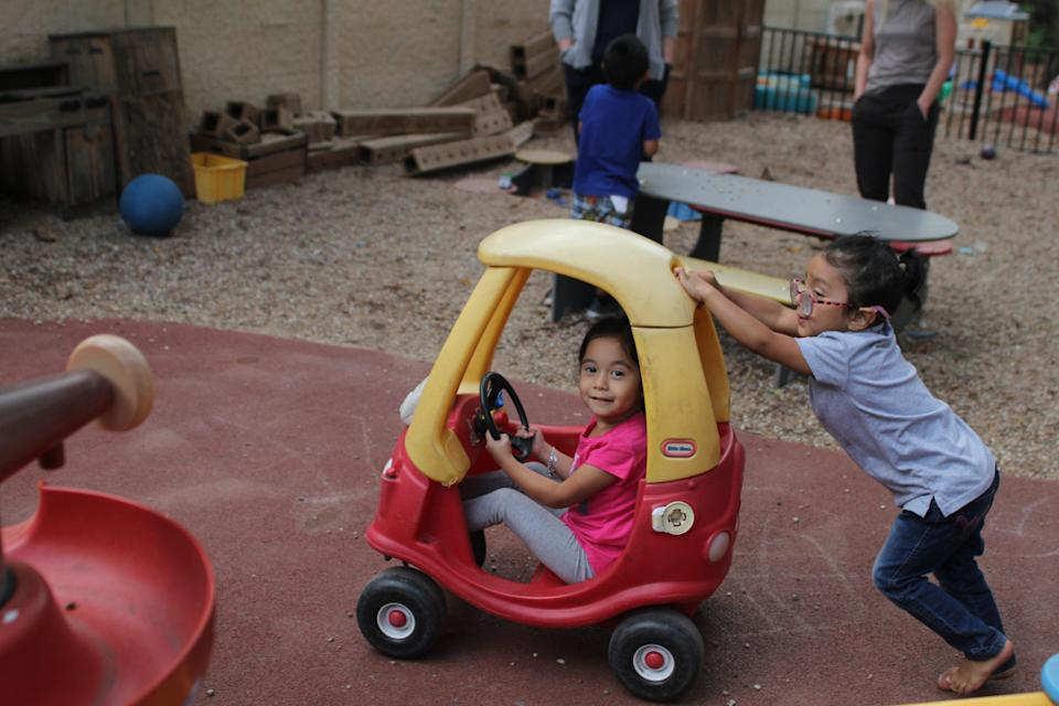 Children play outside at an Open Door Preschools location. All staff at Open Door are required to be vaccinated against COVID-19.