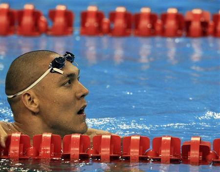 Australia's Huegill watches scoreboard after competing in men's 50m butterfly semi-final at 14th FINA World Championships in Shanghai