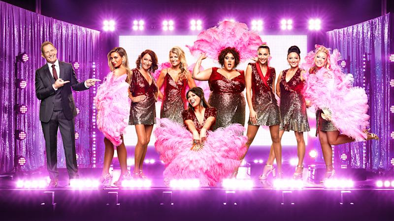 A photo of The All New Monty: Ladies' Night cast in costume on stage: Simone Callahan, Casey Donovan, Nadia Bartel, Lisa Curry, Rachael Finch, Ella Hooper, Lynne McGranger and Georgie Parker.