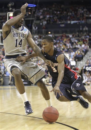 Belmont's Kerron Johnson (3) drives past Georgetown's Henry Sims (14) during the first half of an NCAA men's college basketball tournament second-round game in Columbus, Ohio, Friday, March 16, 2012. (AP Photo/Jay LaPrete)