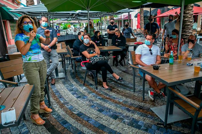 Fiorella Blaco, 46, owner of Fratelli Milano, speaks during an outdoor meeting near Giralda Plaza in Coral Gables, Florida, on Monday, July 6, 2020. More than 30 restaurant owners and staff, from Kendall to the Upper East Side, attended the meeting in opposition of Miami-Dade Mayor Carlos Gimenez's recent order to shut down restaurants this week. He agreed to allow outdoor dining to continue.