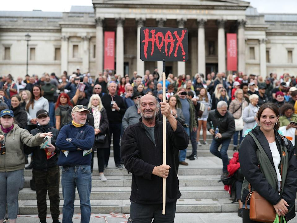 Anti-lockdown protesters, who believe that the coronavirus pandemic is a hoax, gather at the Unite For Freedom rally in Trafalgar Square, London. (PA)