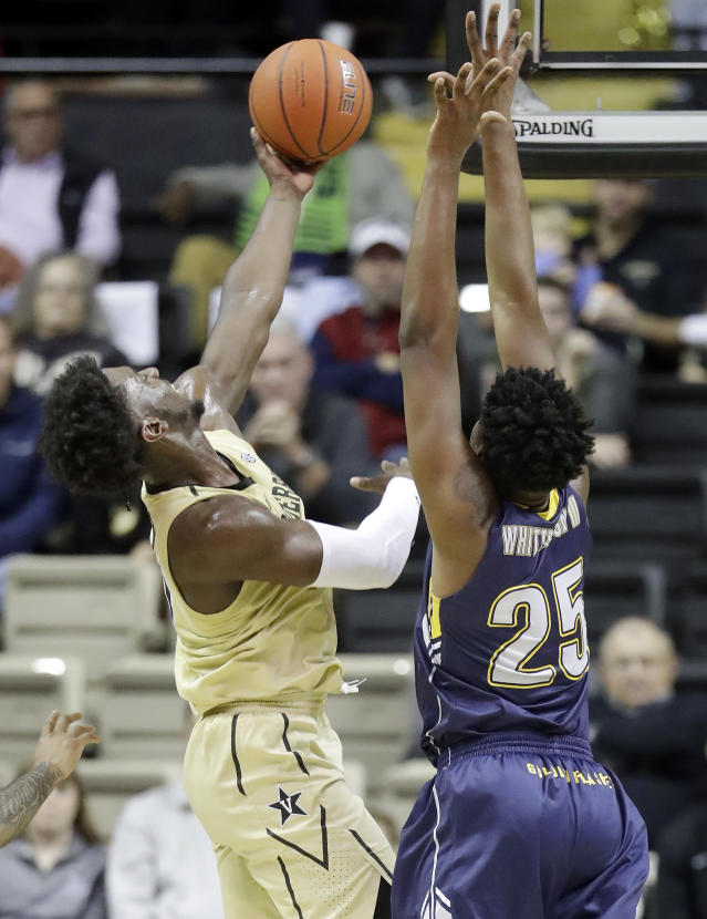 Vanderbilt forward Simisola Shittu, left, shoots against Kent State forward Philip Whittington (25) in the first half of an NCAA college basketball game Friday, Nov. 23, 2018, in Nashville, Tenn. (AP Photo/Mark Humphrey)