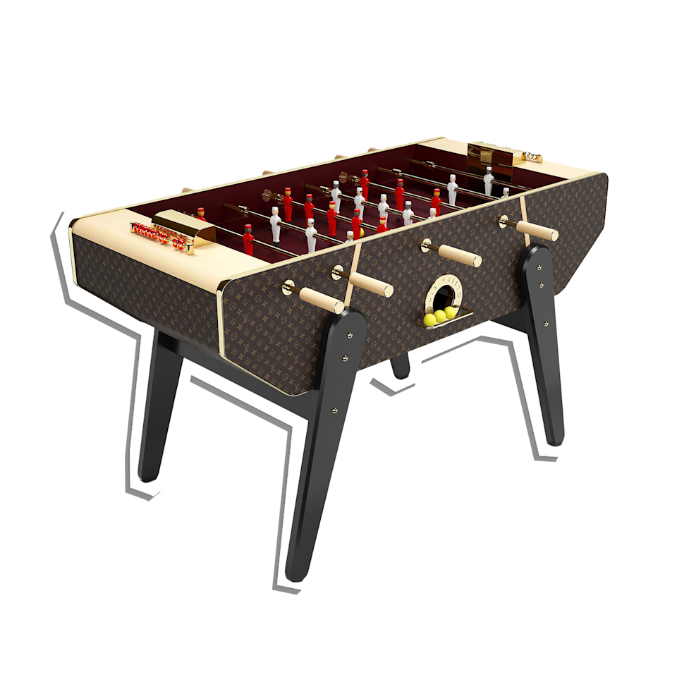 """No details were spared with this luxurious foosball table. Masterfully constructed with durable Epi leather and hand-painted players, your dad's game room was just upgraded to the next level. $71000, Louis Vuitton. <a href=""""https://us.louisvuitton.com/eng-us/products/canvas-foosball-table-monogram-nvprod2210025v#R97265"""" rel=""""nofollow noopener"""" target=""""_blank"""" data-ylk=""""slk:Get it now!"""" class=""""link rapid-noclick-resp"""">Get it now!</a>"""