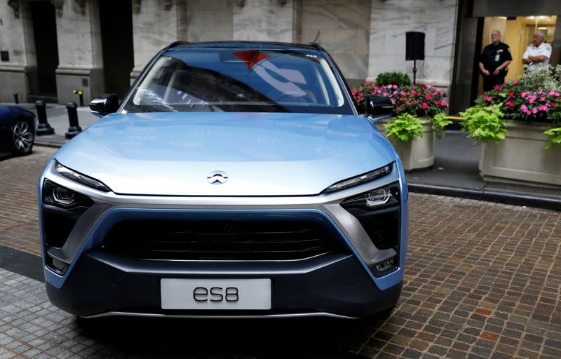 FILE PHOTO: Chinese electric vehicle start-up Nio Inc. vehicles are on display in front of the NYSE to celebrate the company's IPO in New York