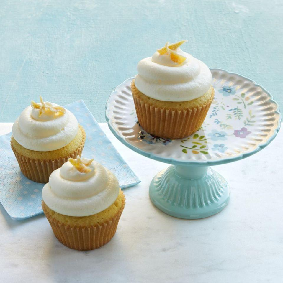 """<p>Put out a big pitcher of lemonade at your BBQ—plus a batch of these refreshing lemony cupcakes! We hear they go great with hot dogs.</p><p><strong><a href=""""https://www.thepioneerwoman.com/food-cooking/recipes/a35449609/double-lemon-cupcakes-recipe/"""" rel=""""nofollow noopener"""" target=""""_blank"""" data-ylk=""""slk:Get Ree's recipe."""" class=""""link rapid-noclick-resp"""">Get Ree's recipe.</a></strong></p><p><a class=""""link rapid-noclick-resp"""" href=""""https://go.redirectingat.com?id=74968X1596630&url=https%3A%2F%2Fwww.walmart.com%2Fsearch%2F%3Fquery%3Dcake%2Bstands&sref=https%3A%2F%2Fwww.thepioneerwoman.com%2Ffood-cooking%2Frecipes%2Fg36343624%2F4th-of-july-cupcakes%2F"""" rel=""""nofollow noopener"""" target=""""_blank"""" data-ylk=""""slk:SHOP CAKE STANDS"""">SHOP CAKE STANDS </a></p>"""