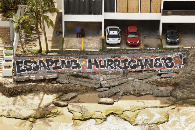 <p>Nearly one week after hurricane Maria devastated the island of Puerto Rico, residents are still trying to get the basics of food, water, gas, and money from banks in San Juan, Puerto Rico, Sept. 25, 2017. Much of the damage done was to electrical wires, fallen trees, and flattened vegetation, in addition to home wooden roofs torn off. (Photo: Carolyn Cole/Los Angeles Times via Getty Images) </p>